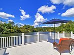Lounge on the shared furnished deck overlooking one of 3 lakes on the property.