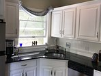 Fully Stocked Granite and Stainless Kitchen