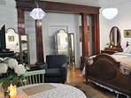 Stunning late-19th century polished mahogany wood pillars sold me on this property