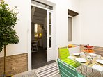 The private patio gives access to the apartment.