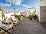 Roof terrace. The apartment building is made up of 3 holiday flats which share 2 terraces.