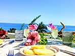 Dine outdoors..overlooking ocean. vacation accommodation, special occasions (garden weddings)