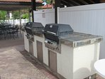Two gas BBQ grills located by the clubhouse.