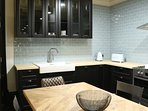 Kitchen featuring butlers sink, high end appliances and full size dining table