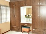 The built-in cupboards provide ample hanging and shelf space.