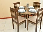 A full crockery set and dining area is available.