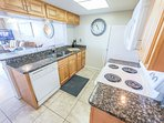 Cook in this kitchen with granite counters, new cabinets while overlooking the ocean