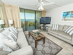 Walk right out onto the balcony, or enjoy a movie in this well appointed living room