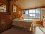 The master bedroom at Someplace Else overlooks the backyard deck and ocean.