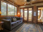 Access the screened-in porch via the doors in the living room area.