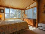 The master bedroom also features a queen-sized bed, dressers, night stand & reading lamps.