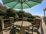 We have two outdoor dining tables on our large backyard deck.
