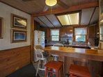There's high-top seating for 4 people at the kitchen counter.