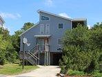 Les Sables Beach Home; driveway accommodate 3 vehicles; basketball alongside driveway