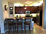 Convenient breakfast bar, plenty of counter space, & full size appliances