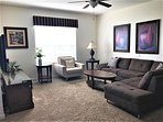 Relax in the spacious Living Room with large sectional, comfy chair, & 50' HDTV
