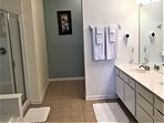 Large master en-suite with dual sinks, shower, and soaking tub