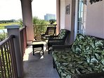 Enjoy the panoramic views from the lanai lounging on the plush furniture