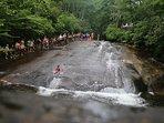 Popular Sliding Rock natural mountain waterfall.