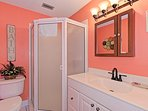 Guest bath features newly remodeled ceramic tile walk-in shower