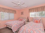 Guest bedroom has one full and one twin size bed