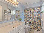 Master bathroom features tub/shower combination and full size vanity