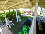 Lower deck area - BBQ, more seating, rocking chairs. Nice ocean breezes!