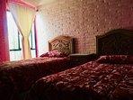 Segunda Recámara con 2 camas individuales y closet