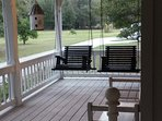 Swing your troubles away on The Cottage wrap around porch