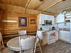 Savor meals from the 4-person kitchen table.