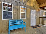 Enjoy the fresh lake air on the furnished porch.