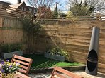 Wonderful, sunny courtyard garden with table, chairs, bbq and chiminea