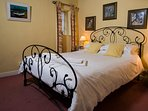 The delightful master bedroom with antique bed