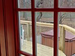 hot tub, new deck as seen from the french doors of sunroom