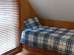twin bed in loft area