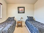After long days in the desert heat, unwind in the fourth bedroom offering 2 twin beds.