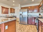 Whip up inspired treats in the fully equipped kitchen with stainless steel appliances.