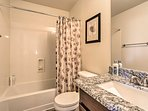 Stay fresh for daily expeditions by rinsing off in this full bathroom with a shower/tub combo.