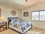 This bright and breezy bedroom is adorned with a plush queen bed and an en-suite bathroom!