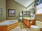 Take a relaxing soak in this large jacuzzi tub.