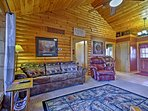 As you lounge on the couch you'll feel the heat of the wood-burning fireplace fill the room.