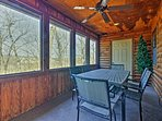 The screened-in porch is a great place to enjoy a meal.