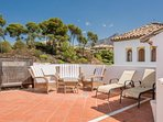 Private sunbathing on top terrace with mountain views, BBQ and Dining areas