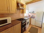 Well-equipped kitchen, including washing machine and dishwasher