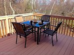 Outdoor table and chairs on the deck.