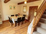 The spacious dining room and stairs to 2 bedrooms