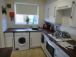 Fully equipped kitchen with new Zanussi washing machine