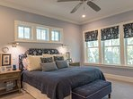 This luxurious room has a king bed. Blues and grays create a peaceful retreat.