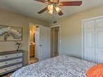 The master bedroom includes the added luxury of an en-suite bath.