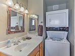 The second bathroom also features in-unit laundry machines.